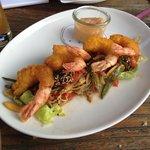 tempura shrimp on a bed of salad