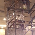 Workmen cleaning the chandelier