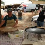 Preparing local pie at the market