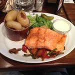 Trout with salad and vegtables.