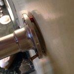 Heated towel rail coming off wall.