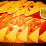 Tabla of Manchego cheese and Serrano Jamón with Olive and Tomato Bread
