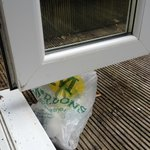 Filthy balcony, bags and cigarette butts, not child friendly
