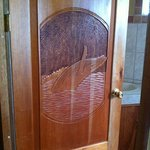 carved door on bathroom oif #15