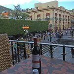 View from balcony table overlooking the plaza garden