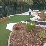 Our son playing mini-golf