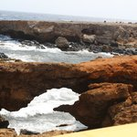 Natural land bridges formed by the waves.