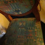 """Stained torn up chair in my """"deluxe king"""" room"""
