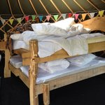 Double bed with two single beds underneath which pulled out when in use
