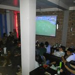 Gattys Cafe, Darjeeling during World Cup 2014 . Projection lounge room