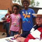 Ken High, Palo Duro Plein Air Artist, just autographed these guest of TEXAS, 49th season souveni