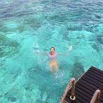 Swimming in the lagoon off our water bungalow.