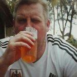 Me enjoying a tusker beer.