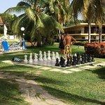 Outdoor chess board in between pools