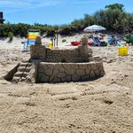 Sandcastle on Beach in front of Apartment Building