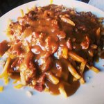 Shoe-string fries, bacon, smoked meat, cheddar cheese, cheese curds, and poutine gravy