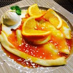 Crepes Suzette w/ vanilla ice and orange sauce