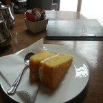 Dry lemon drizzle cake with tea puddle on menu