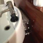basin pulling off wall