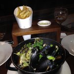 1kg pot of mussels in white wine & garlic sauce, served with Pomme Frittes.