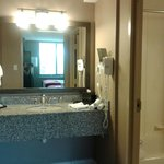 I loved this vanity area & second sink outside the bathroom