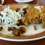 Mofongo with fried pork and onions