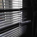 shabby broken blinds in the luxury room