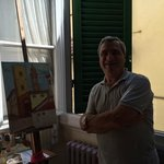 Bruno, our host shows us his painting