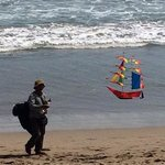 a kite seller on the beach