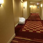 Linens and trash in hallway awaiting pickup
