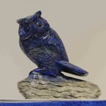 An intricate carving of an owl. Lapis lazui.