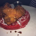 Tasty fried chicken and red velvet waffles