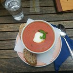 Amazing Tomato soup with goat cheese and basil