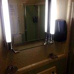 Original vanity lights in the bathroom of Room 109.