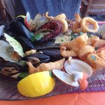 Seafood platter for one - loads on here you can't see - large prawns, whole sea bass, calamari,