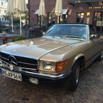 A beautiful Mercedes in front of a wonderful hotel