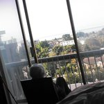 My mom gazing at the view from the 10th floor towards the Strait of Juan de Fuca