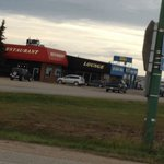 Easy to find just look for the truck that's mounted high above the tempo gas station!