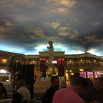 The foodcourt across the road with a fake blue sky and David statue