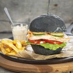Black burger with salmon steak
