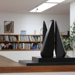 A Hepworth sculpture with the library beyond.