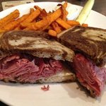 Very nice reuben sandwich with a side of sweet potato fries