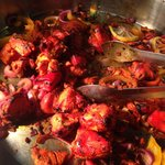 Tandoori Chicken on a buffet hot plate