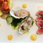 Surf's Up Appetizer with smoked trout, seared Ahi tuna and oysters. Yum!