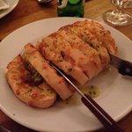 """A """"single"""" portion of cheesy garlic bread."""