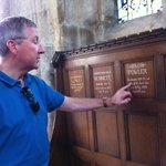 Ken Fowler shows where his father's name is listed.