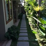 Pathway along the side of pool to rooms
