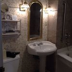 Super clean and spacious bathroom in room w/two beds & garden view.
