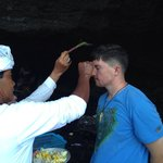 Receiving a blessing at Tanah Lot Temple.