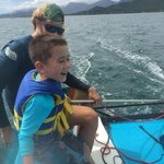 Garret showing my son how to sail